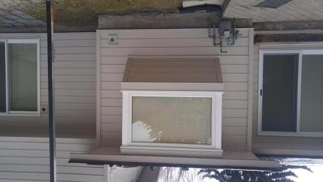 Calgary, AB - Cobblestone Hardie Plank Siding and Smooth Hardie Trim also Cobblestone. Arctic White Hardie Trim accents on the box out window...Sweet!