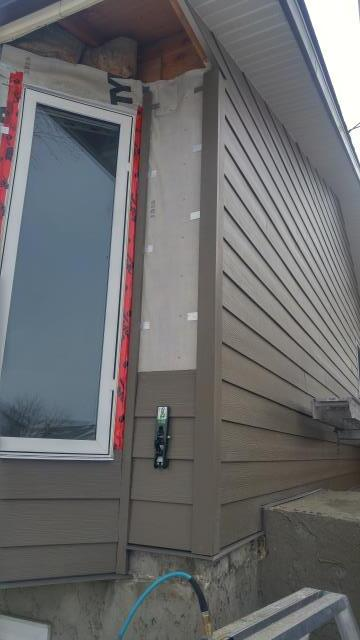 Calgary, AB - North West Calgary Hardie Plank Install - Timberbark. Hardie Trim also Timberbark. Banff Springs Cliffstone and Knotty Teak Lux panel to come....stay tuned!
