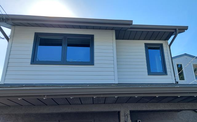 "Calgary, AB - NW Calgary updated the old vinyl siding, installed new James Hardie 5"" exposed ""Light Mist"" lap siding with 3.5"" NT3 smooth Hardie Trim. Works great with the new Fusion Colour Wrap North Star windows in Anthracite Grey!"