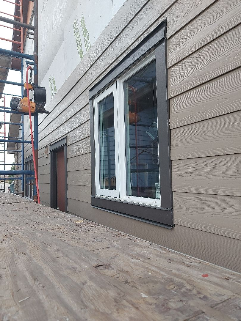 Calgary, AB - An in process shot of the Woodstock Brown Hardie Plank and the Rich Espresso Hardie Trim in SE Calgary
