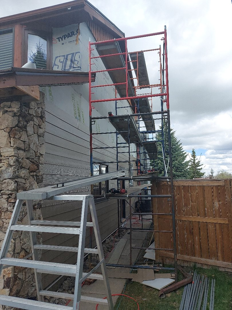 Calgary, AB - Another James Hardie Wrap in SE Calgary, Woodstock Brown Lap Siding, windows trimmed out in Brown Blaze from the Hardie Dream Collection otherwise known as Rich Espresso.