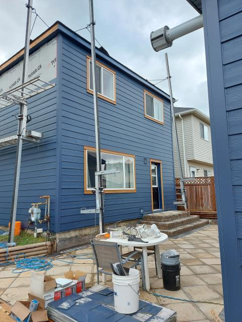 Calgary, AB - Hail damaged vinyl out, Hail Resistant James Hardie Siding in. This project features Deep Ocean Hardie Shake, Deep Ocean Hardie Lap Siding with Deep Ocean corners. The windows have been trimmed out in two tone James Hardie NT3 Roughsawn Trim.