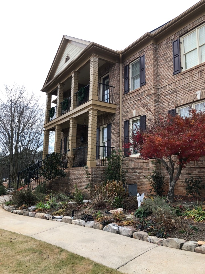 Roswell, GA - Illuminated customers home with outdoor landscape lighting