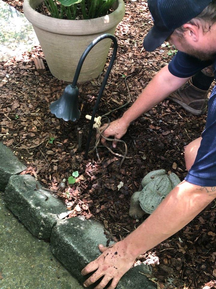 Atlanta, GA - Repairing customers Landscape Lighting system.