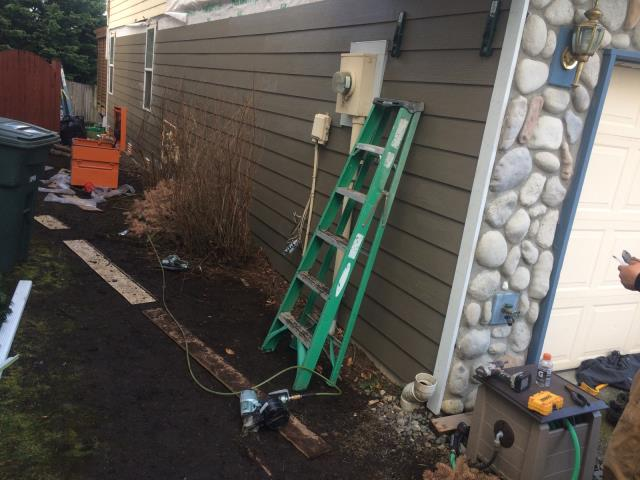 Everett, WA - Hard at work! Stone is done & siding is coming along nicely.