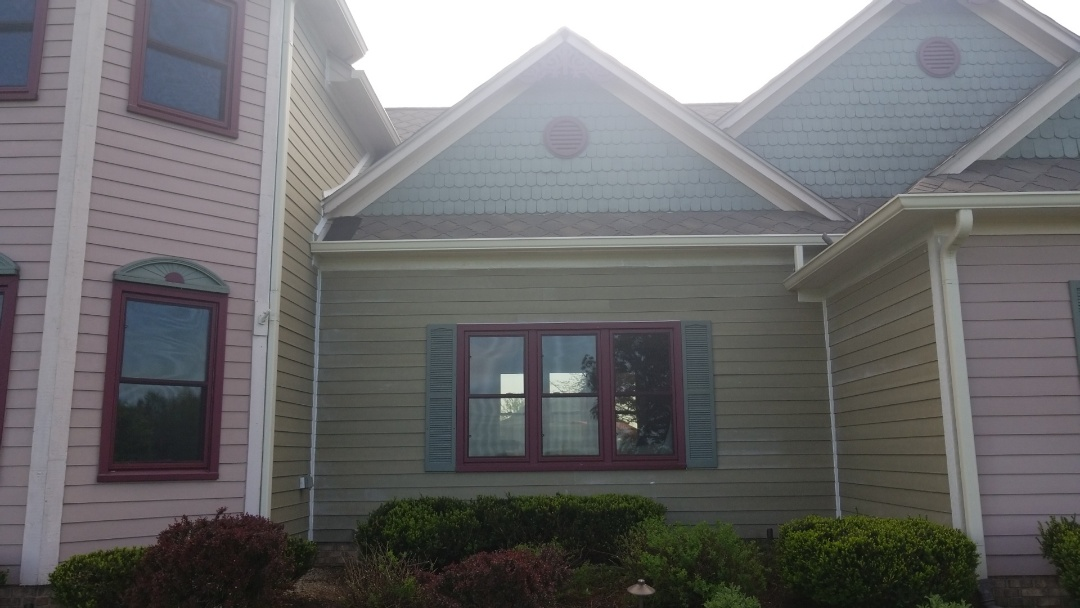 Greenwood, IN - Replace leaking siding and roofing section with Primed James Hardie Siding.