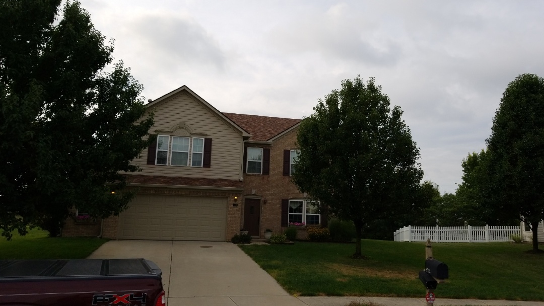 Avon, IN - Roof was damaged by wind. Insurance paid for replacement. It was replaced with Owen's Corning Shingles and new gutters were installed.
