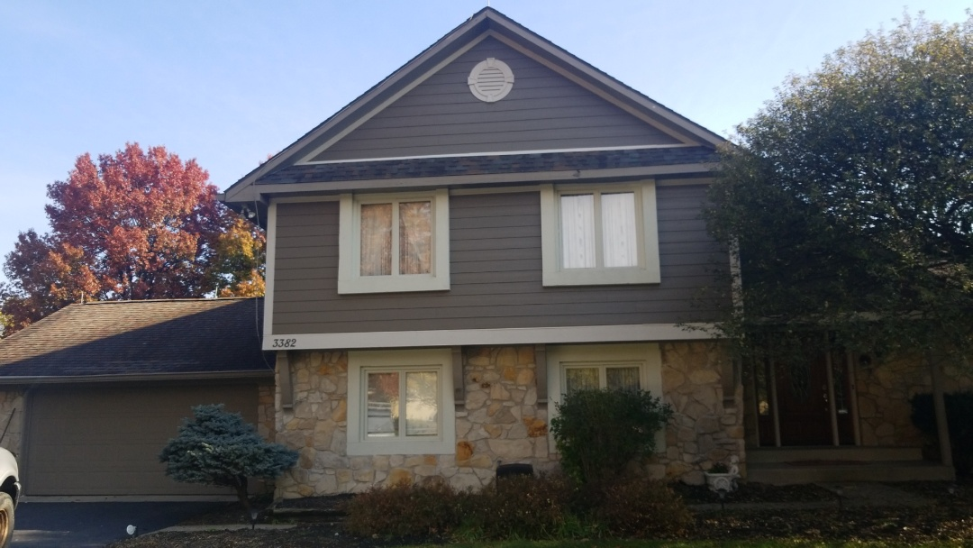 Carmel, IN - Client had rotted and failing wood siding. UHQ Construction replaced it with James Hardie Siding.