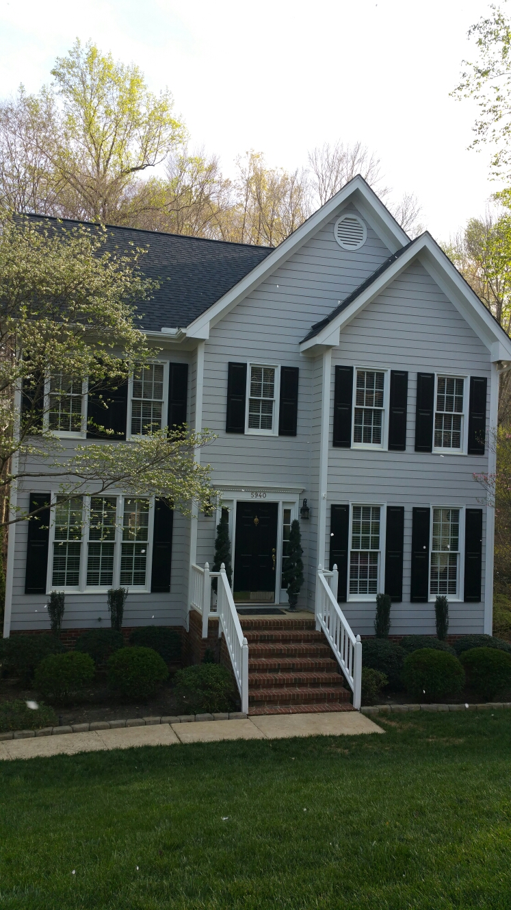 Roof hardiplank siding and painting by Spilman,inc.
