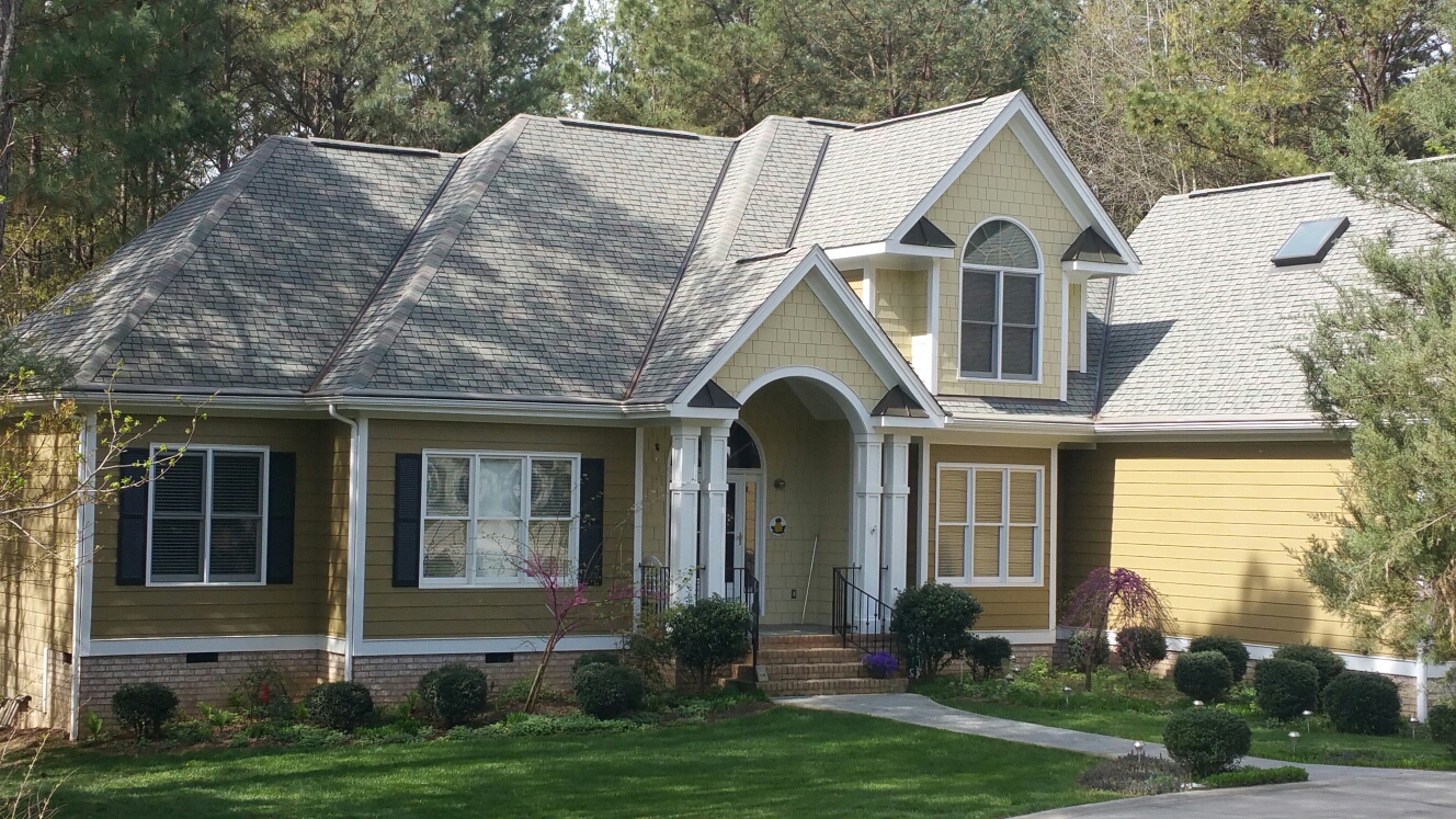 Custom home built by Custom home builder J.Chris Spilman for Wake county Parade of homes, 2003. Still looking Fantastic!!! Especially the Capstone Luxury roof shingles w/copper valleys and accents....call or click Today!!! (919) 510-0280. www.spilmaninc.com
