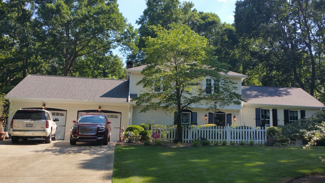 New lifetime roof, new paint, new hardi-plank fascia boards, and new seamless aluminum gutters with leaf guards, All by Spilman and his crews.....warrantied work with Outstanding quality, for an unmatched value! Call or click today! (919) 510-0280 www.spilmaninc.com