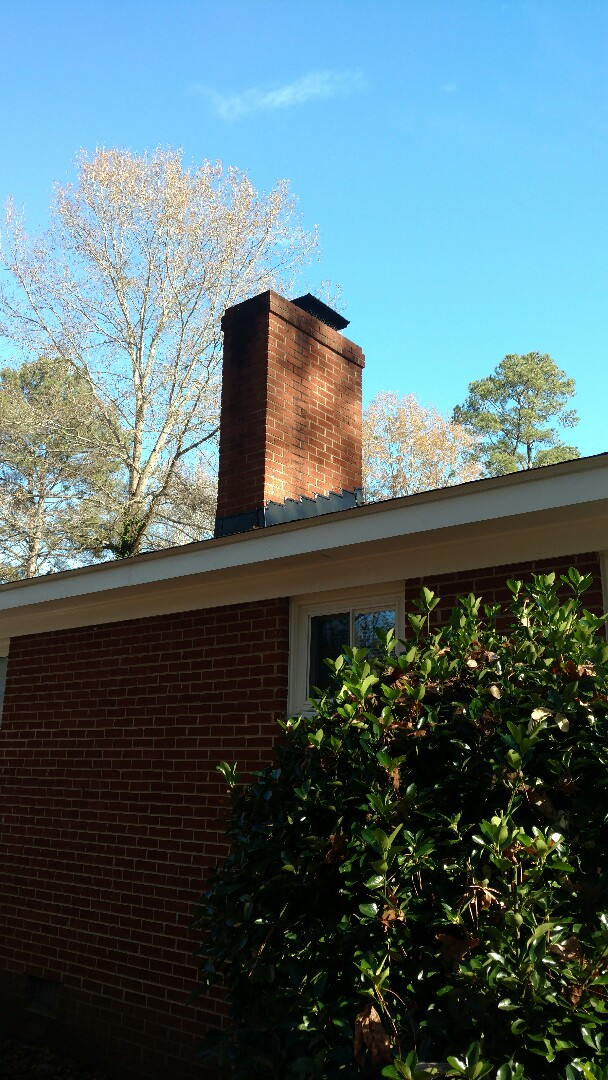 Proper chimney flashing, Counter & Step flashing on Brick chimney by Spilman, Inc. in Apex, NC...call or click today! -Fully insured. -Quality Workmanship. -Longest Labor warranty. -Numerous references. -Value You Can Afford. -Free Estimates. www.spilmaninc.com or call (919) 510-0280.