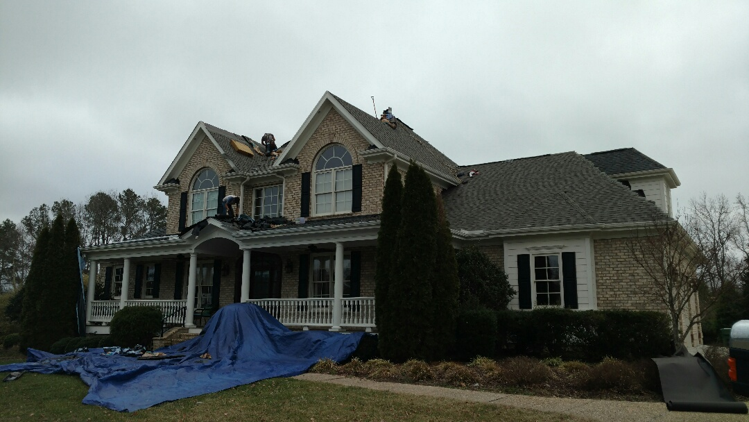 Spilman,Inc.'s Highly skilled and organized installation crew tackling this Gorgeous  southern colonial traditional brick home with ease, and efficiently install Certainteed's Landmark shingle, w/Limited Lifetime Warranty. And the Price, Too Low to list; unbelievable value, when compared to the 4 competitors price, for The SAME SHINGLE!! Call us @(919)510-0280 for Free Estimate...OR, Go online to read more reviews of Spilman work. www.spilmaninc.com