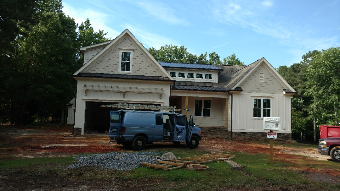 Beautiful new construction with lifetime warranty Roof in North Raleigh, off Pleasant Union Church Rd. Spilman,inc. Roofing PROS...