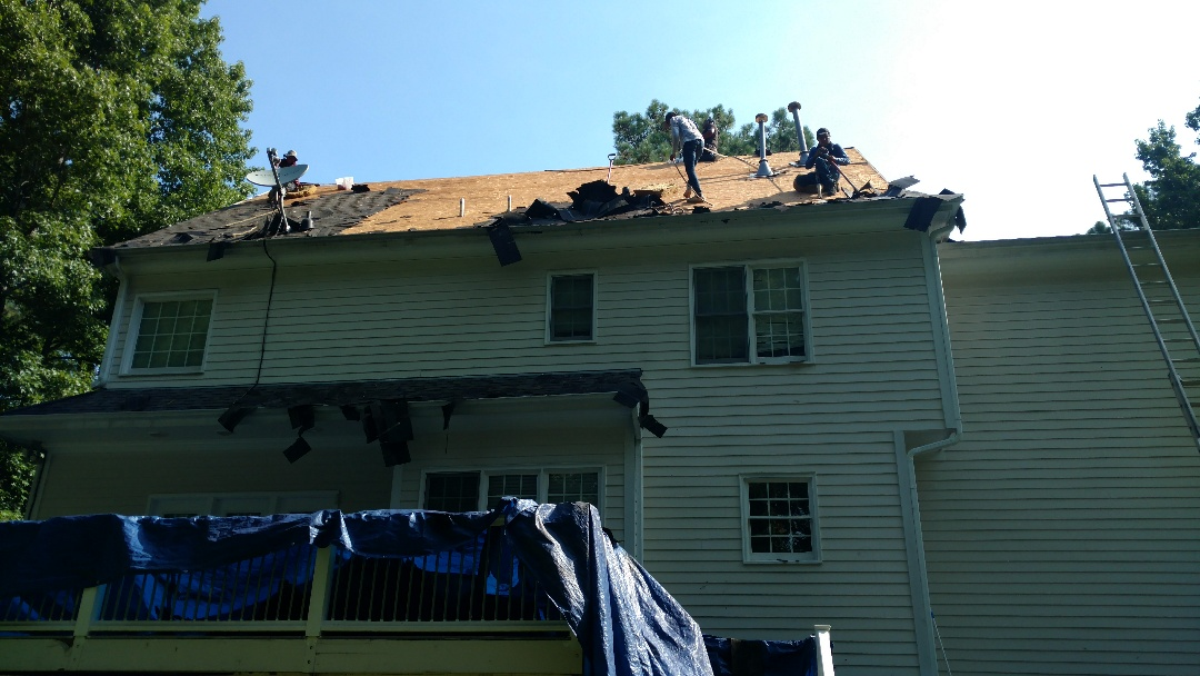 Wake Forest, NC - Removing an old roof in 95 degree sun is Grueling Work, but these professional Roofing Installers make Easy work of it. Even in themost difficult situations, Safety and Care is taken seriously to be certain it goes as planned. Weather, as well as jobsite conditions can play a factor in our line of work. Sometimes, we receive praise from customers for just doing the basics or simplest thing; like running nail magnets in flower beds, Or sweeping a driveway BEFORE a Flat tire!! www.spilmaninc.com