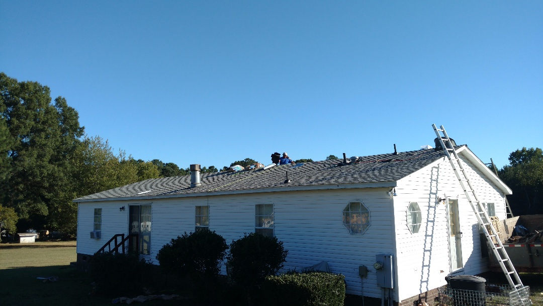Another Raleigh home owner gets a new Lifetime Warranty Architectural roof from Spilman,inc. Roofing PROS!! We put on the Best quality roof for a value... skylights that Never leak!! We install Aluminum dripedge when competitors leave it out. We Explain the process and offer options and guarantee our workmanship, Always. Call TODAY...(919)510-0280 www.spilmaninc.com