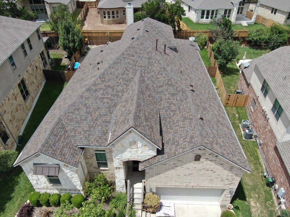 Cedar Park, TX - Hail storm damage on roof. Full insurance claim roof replacement. Owens Corning Duration Teak.