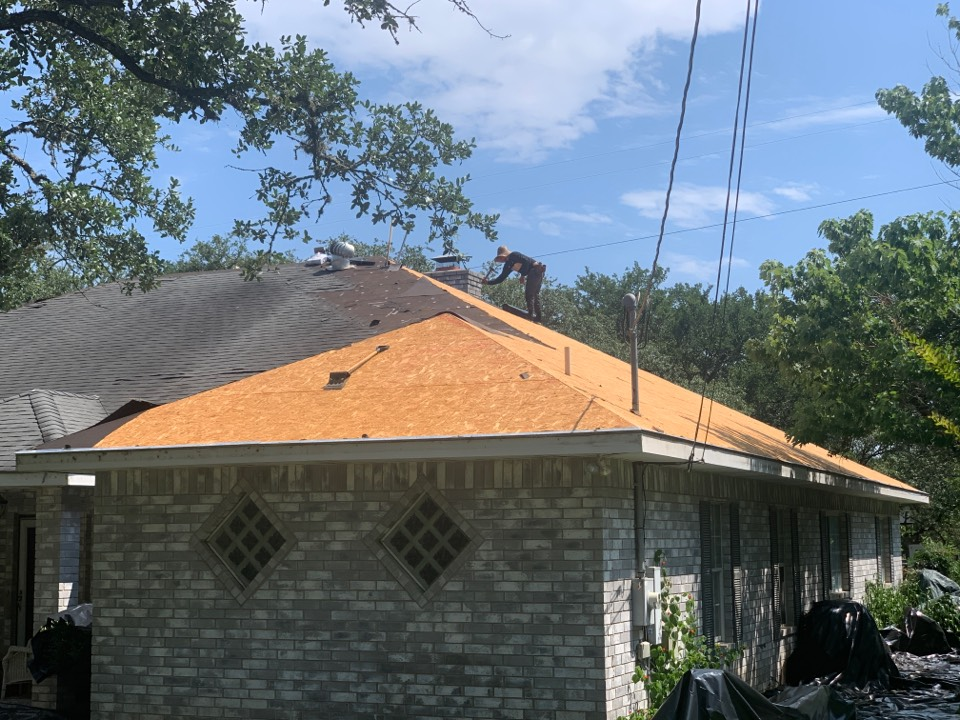 New Braunfels, TX - Nice day to replace a roof. We helped our customer with their insurance claim to replace the roof and gutters. Call me at (210) 840-5590 with OnPoint Premier Roofing for free inspection and help with your claim.