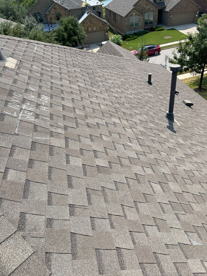 Cedar Park, TX - Cedar Park hail damage roof inspection.  OnPOint Premier meeting with adjuster on insurance claim. Full replacement.