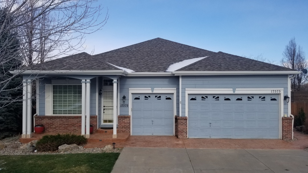 "Parker, CO - We finished up a new roof replacement on this house with new 6"" gutters and gutter screens because next week comes his new solar panels! We installed Owens Corning Duration shingles in Driftwood color. This roof was inspected due to the solar panel installation but we actually had this roof approved for replacement with insurance proceeds from the hail storm in Parker last year."
