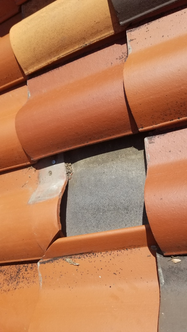 Denver, CO - We completed a tile roof repair on this clay tile roof