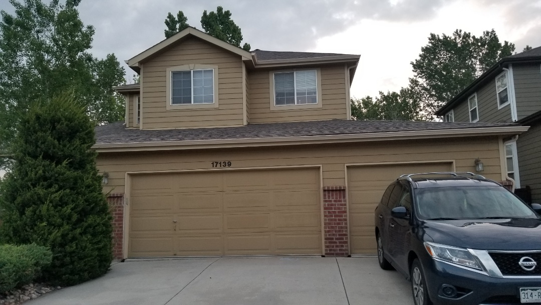 Parker, CO - We did a full gutter and downspout replacement on this house in Parker. We also installed drip metal at the edge of the roof to ensure water got into the gutter and not behind it like it was before.