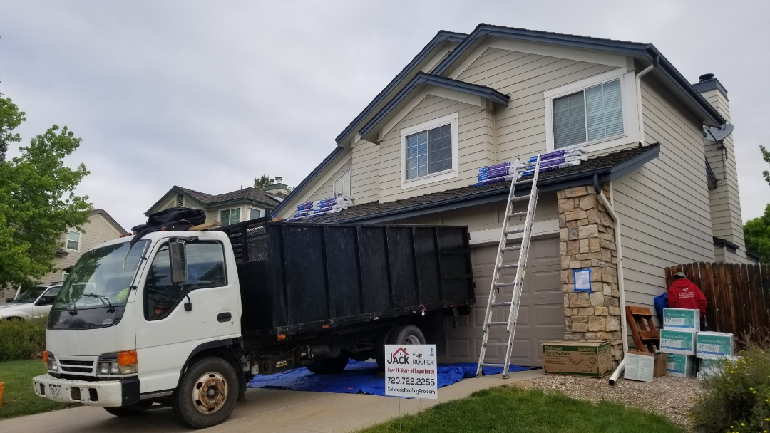 Parker, CO - We are doing a full re-roof in Parker today. The roof was approved for replacement due to hail damage. We are installing CertainTeed Presidential TL shingles in Weathered Wood color