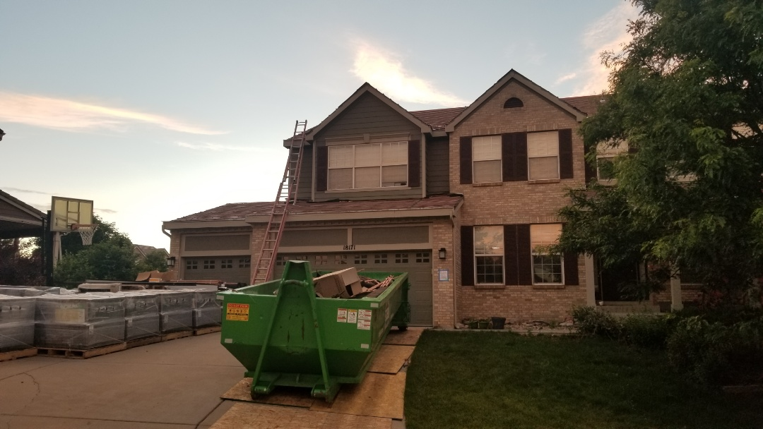 Aurora, CO - We are re-roofing this house with new Boral concrete roof tiles. The old roof was damaged from hail and the insurance company paid to have the roof replaced.