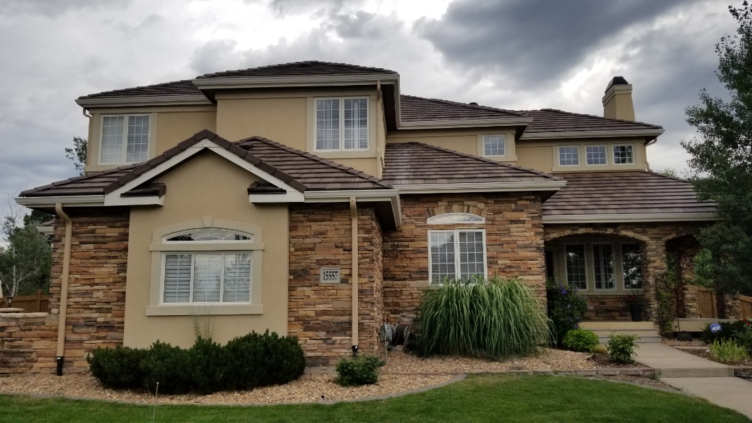 Centennial, CO - We replaced this tile roof because of the hail damage to the roof last year. We replaced the roof and gutters and did other work using insurance funds. We installed Class 4 impact resistant Boral tiles