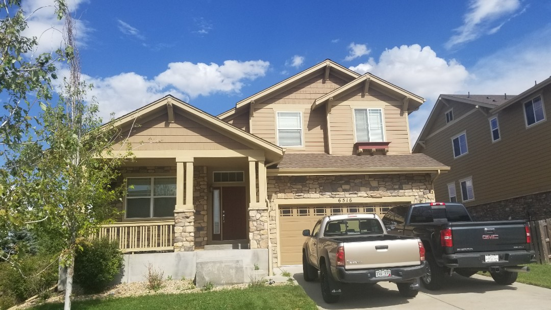Aurora, CO - We are doing a roof inspection here in Aurora in South shore and finding hail damage to the roof and gutters.
