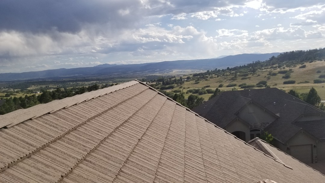 Castle Rock, CO - We are doing a concrete tile roof repair for this house in Castle Pines that has leaking around his chimney