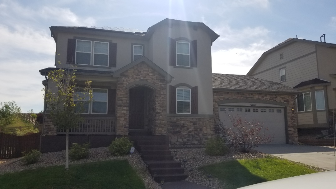 Aurora, CO - We are inspecting for hail damage on this house in Aurora and found that it will require full roof replacement and new gutters and some painting to be done