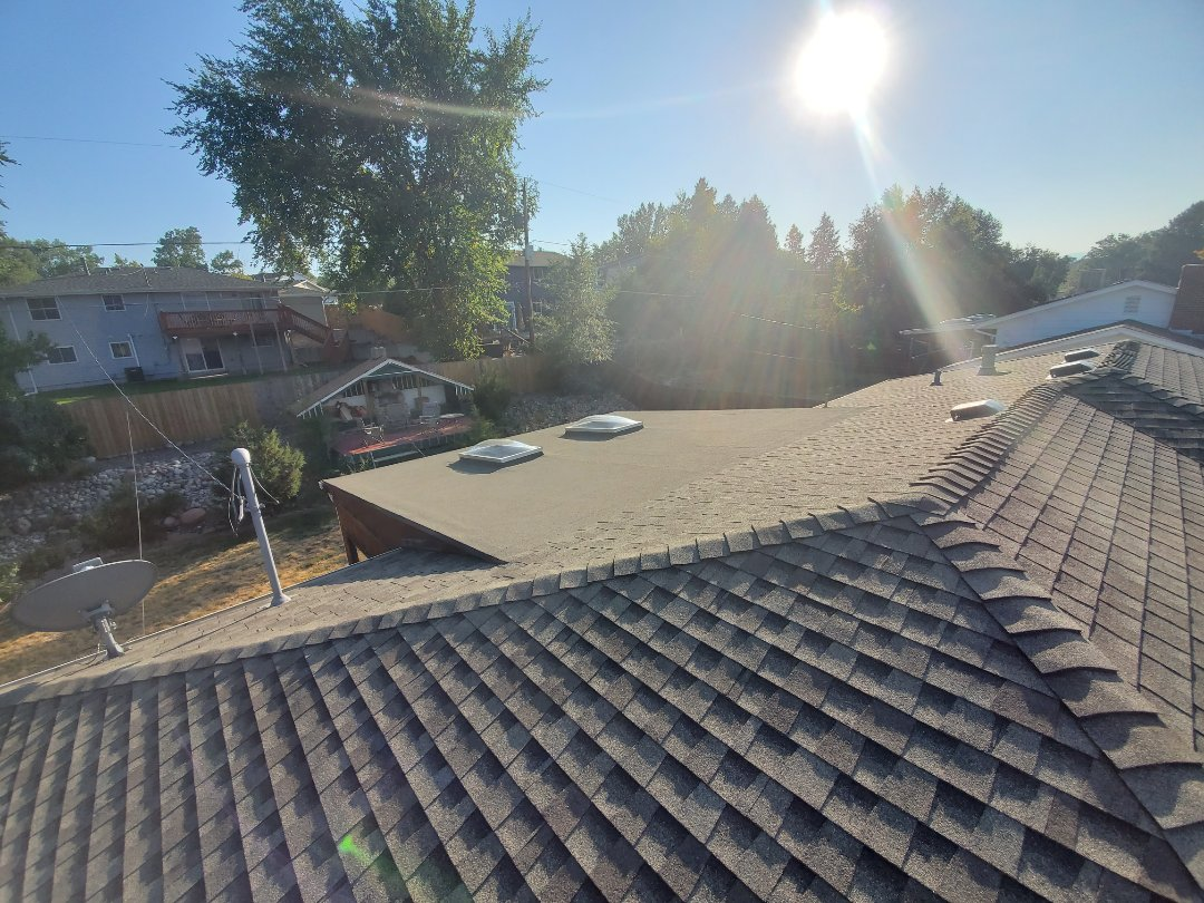 Denver, CO - We are doing a roof inspection for a roof replacement in Denver that has been approved by insurance. Current roof is GAF Timberline HD, weathered wood color and some flat roofing with skylights
