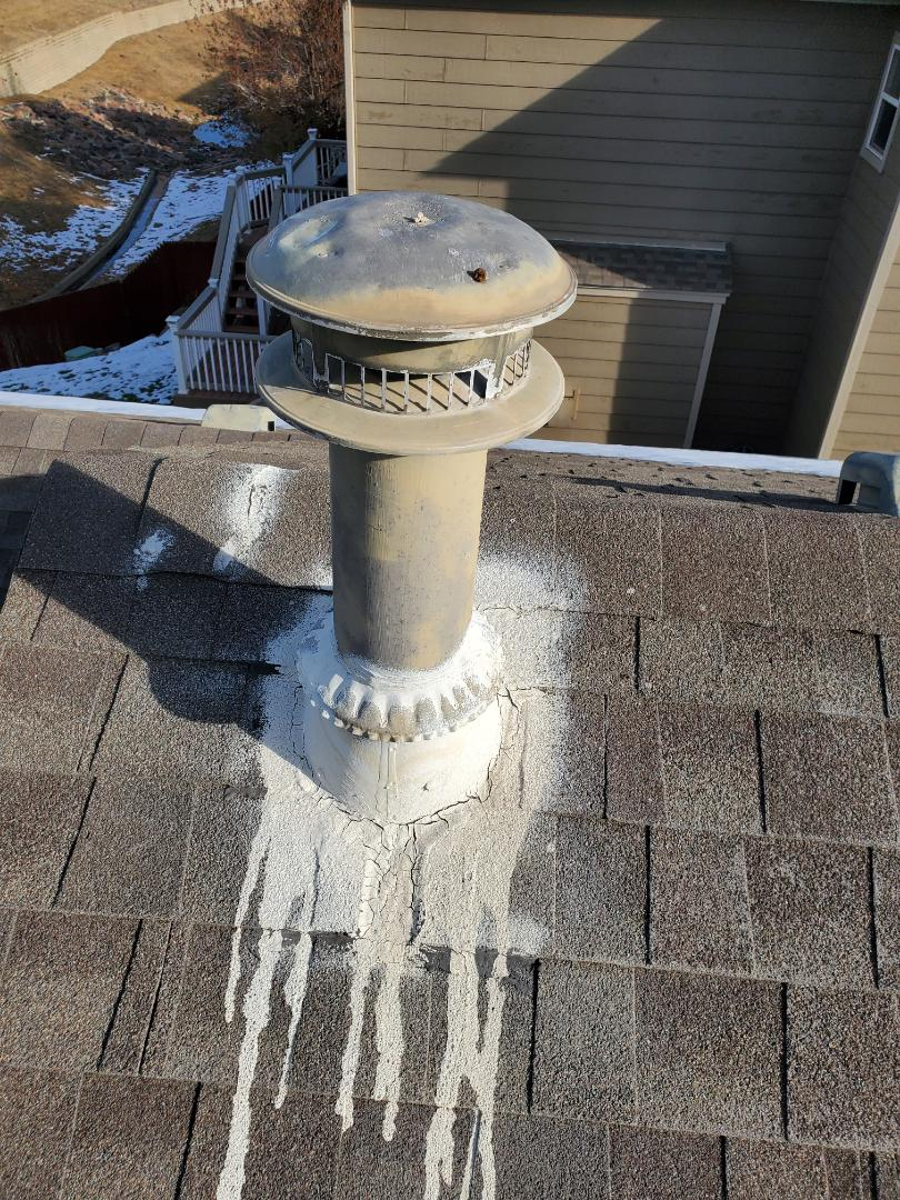 Parker, CO - We are fixing a roof leak in Parker, CO that is coming into the roof around a furnace flue that has been improperly fixed. We are replacing the base flashing and collar and cap to ensure no more water gets in to the attic