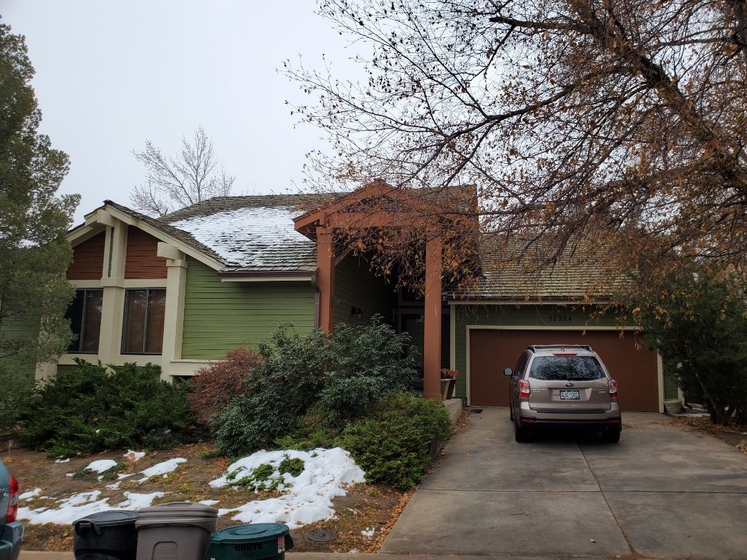 Aurora, CO - We are going to do a full roof replacement on this house in Aurora. The old wood shake roof is coming off and will be replaced with a new asphalt roof.