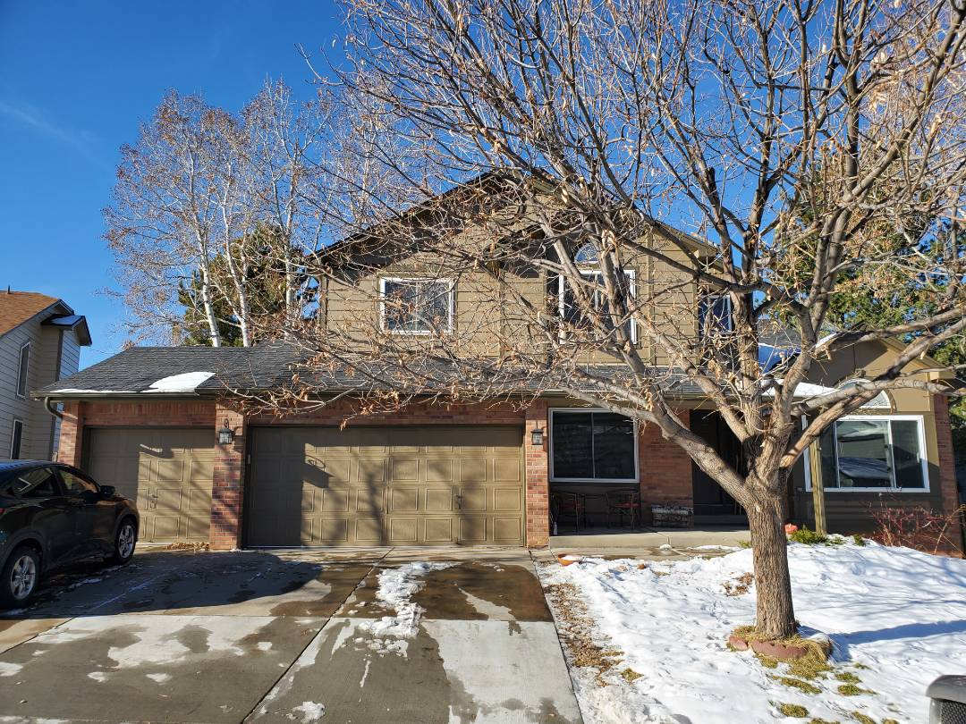 Aurora, CO - We are doing a roof repair on this house in Aurora where a tree has been running against the roof for a long period of time.