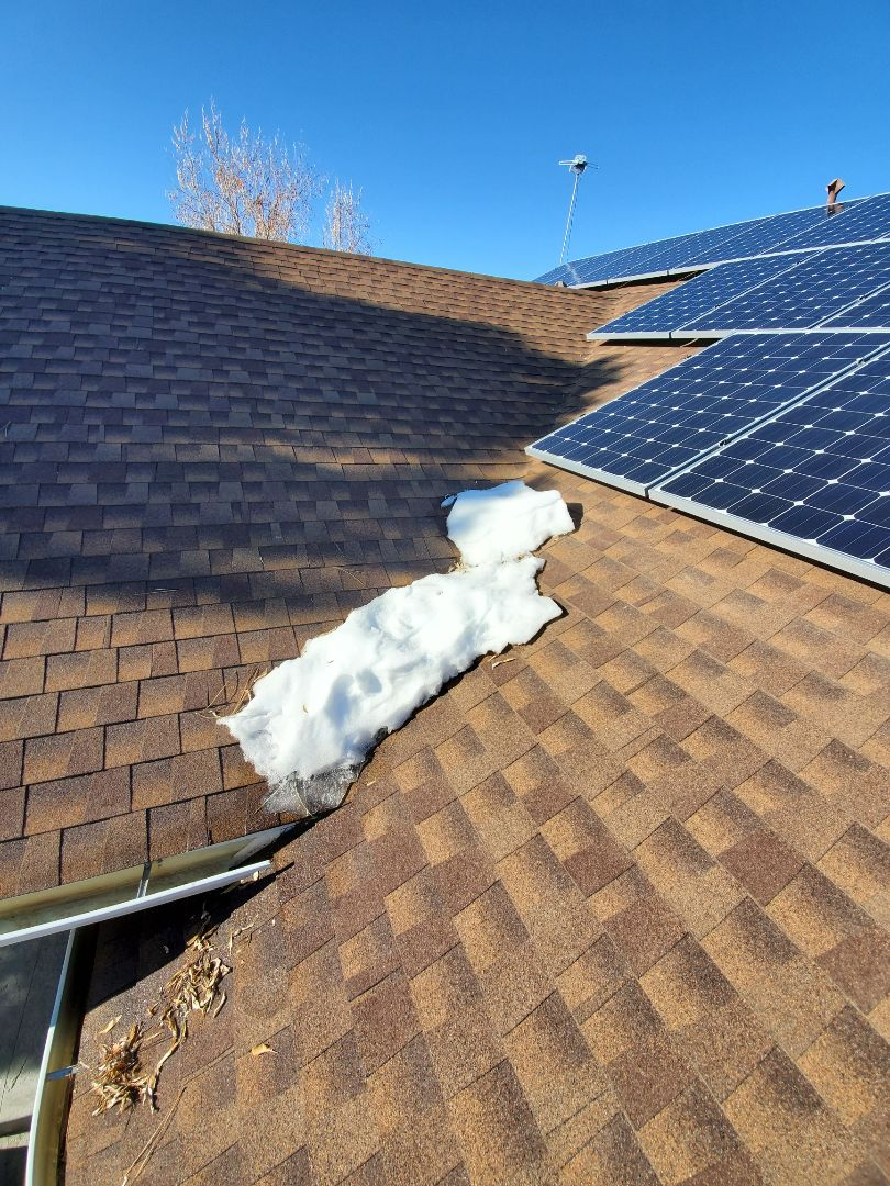 Centennial, CO - We are assessing a roof leak that we think is being caused by ice damming. We are proposing to install heat tape in the valley to fix his roof leak