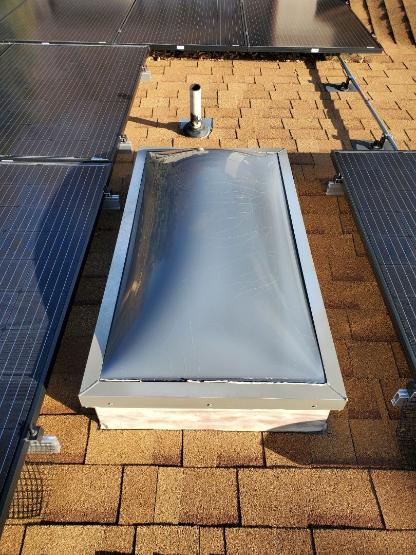 Centennial, CO - We are doing a roof inspection for a leak around solar panels on his roof. We found some exposed nailheads and some minor issues with a skylight