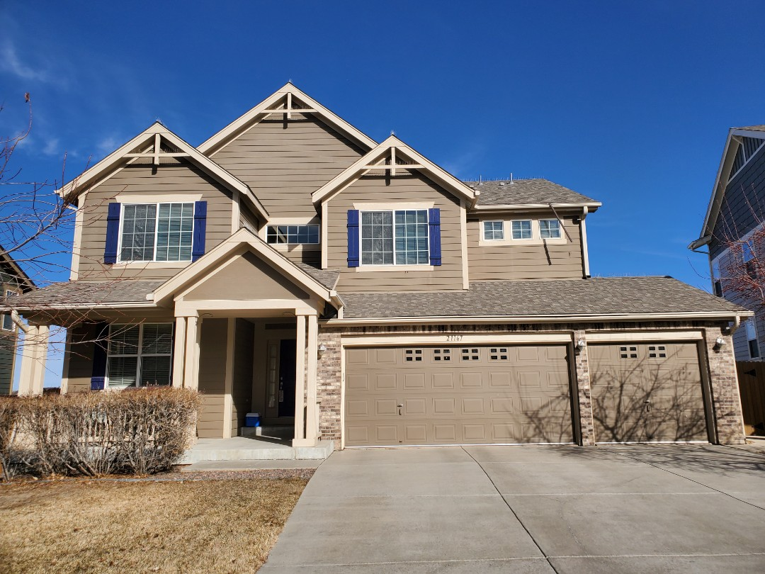 Aurora, CO - We are doing a roof repair for this house in Aurora where some flashing has come dislodged off the eave.