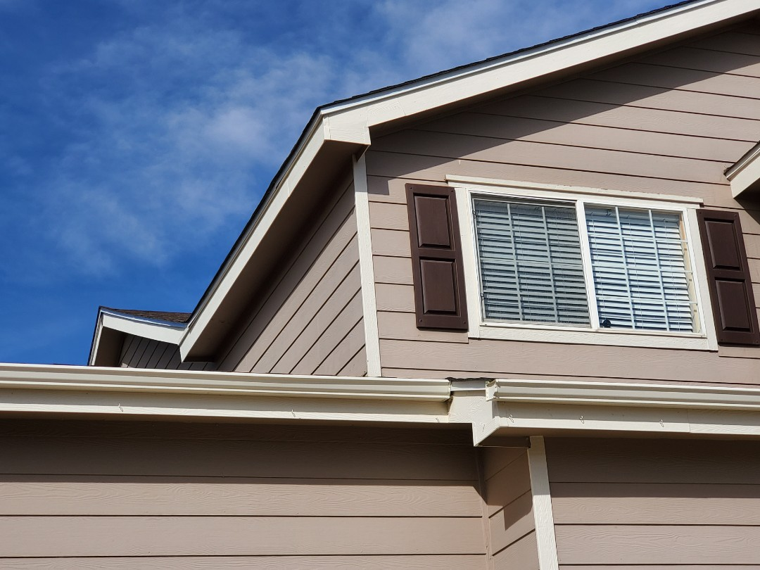Parker, CO - We are installing a new gutter on a house where no gutter and downspout previously existed. Homeowner was having problems with water splashing back and damaging siding.