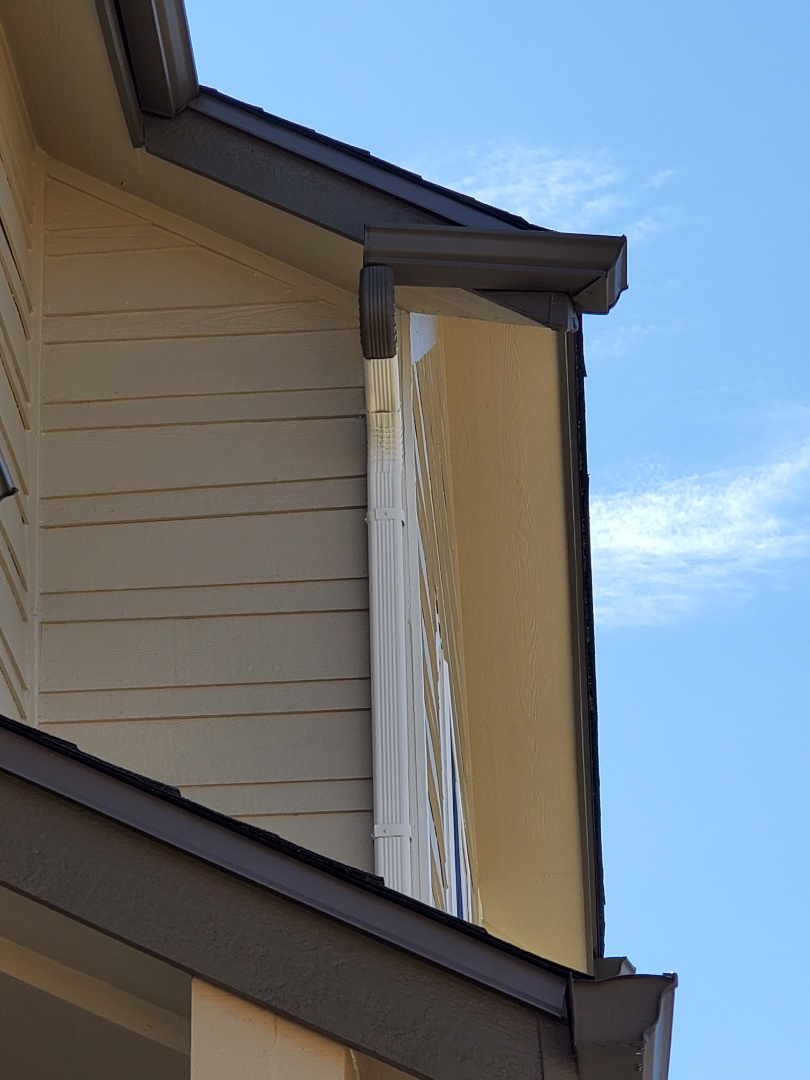 Parker, CO - We are quoting a gutter repair job in Parker today. The rain comes down to a gutter that isn't sloped properly and freezes and over time the gutter started splitting. It will need to be sealed and resloped towards the downspout