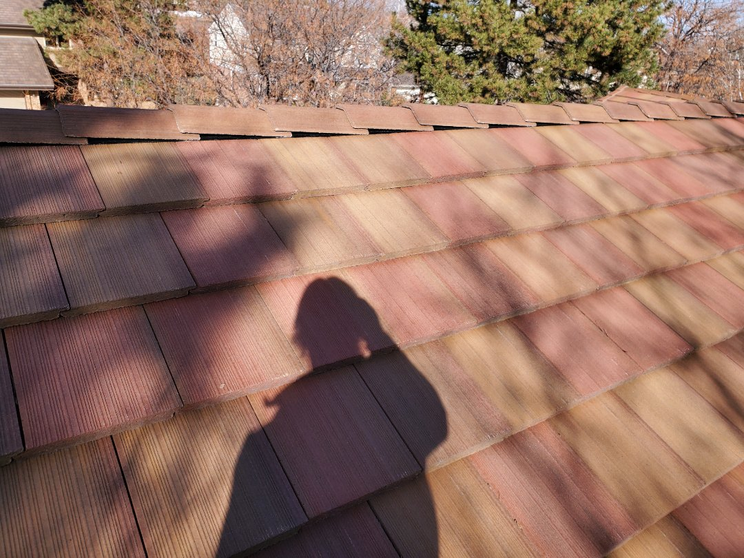 Englewood, CO - We completed a concrete tile roof repair for this house that had some broken roof tiles from a branch landing on it