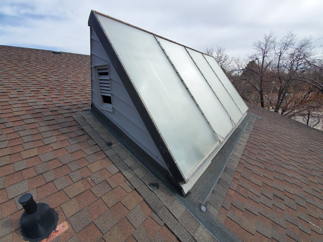 Aurora, CO - Today, we are in Aurora looking at a roof that has a roof leak coming from an old solar array. there are a few issues with regards to the array, but we are recommending removing the entire structure and replacing the roof shingles in that area. Due to the age of the roof, the shingles may not match so we are also recommending either the entire slope be replaced or the entire roof be replaced.