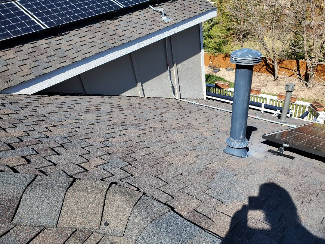 Littleton, CO - We are doing a roof repair for a house in Highlands Ranch where the roof was leaking around a vent pipe and around some new solar panels