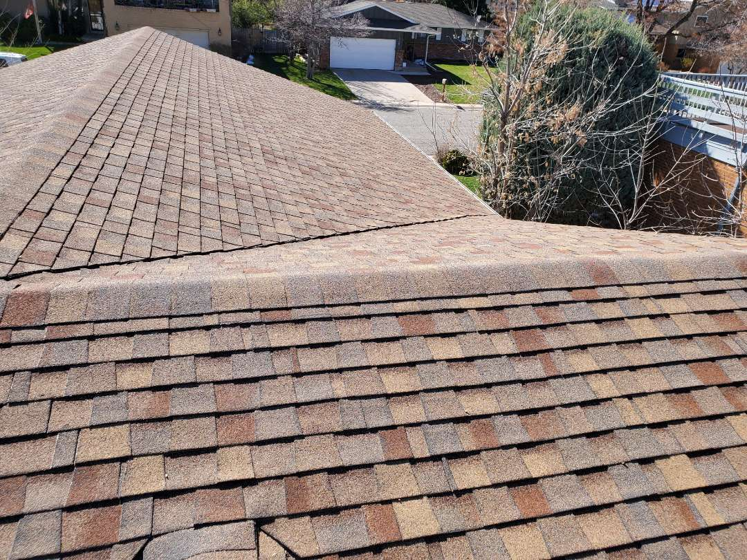 Denver, CO - We are evaluating this roof in Denver because the house is going to be sold and we are recommending a full roof replacement so that it doesn't come up on the buyer's roof inspection. The gutters also need to be replaced as they have hail damage to them.