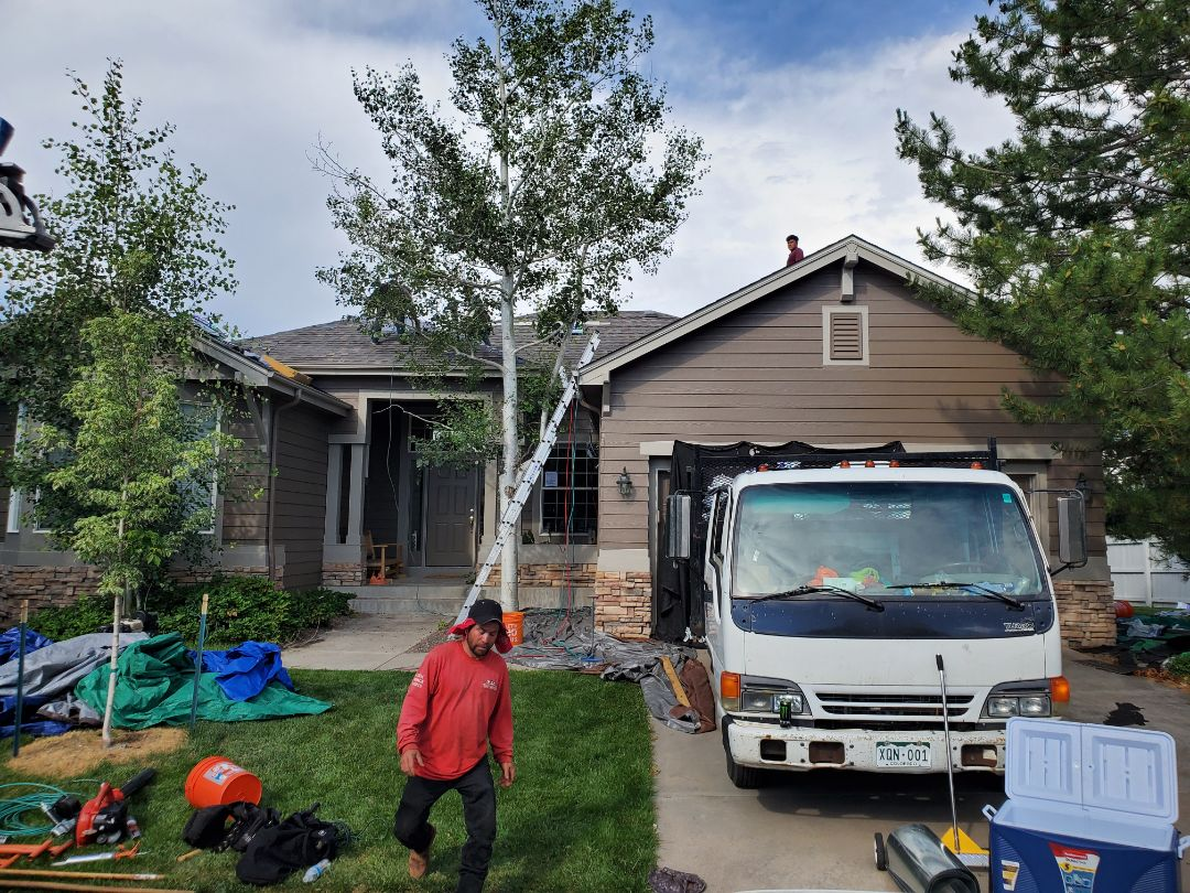 Castle Rock, CO - We are doing a full roof replacement for this house in Castle Pines. We are also installing new gutters