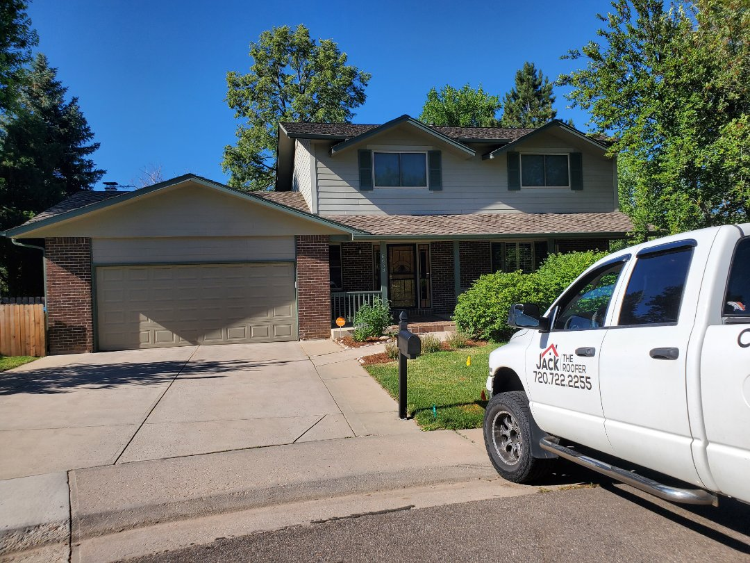 Centennial, CO - We are doing a roof inspection for a possible installation problem on a presidential asphalt shingle roof