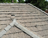 Littleton, CO - We are doing a roof repair for a concrete tile roof in Littleton that has old Eagle lite tiles that break easily when pressure is applied. These roof tiles are no longer available in Denver so they must be procured at a salvage yard
