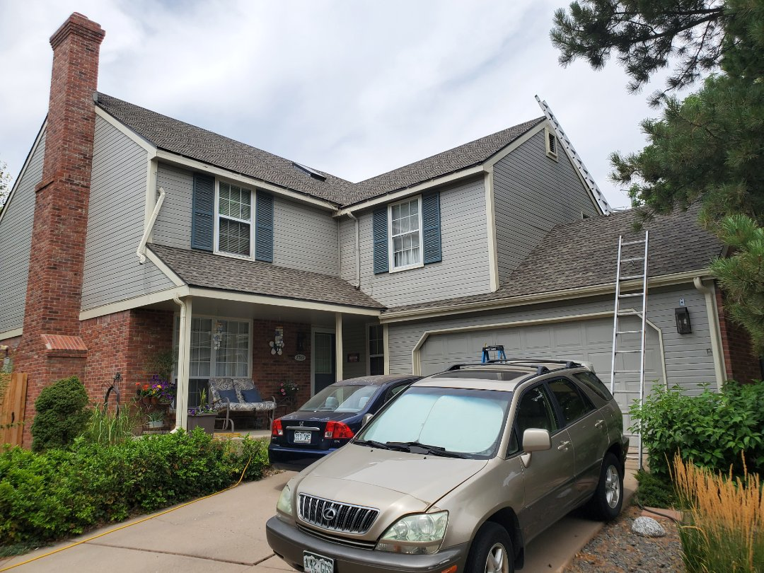 Centennial, CO - We are installing new gutters on this house in Centennial with new 5 inch aluminum gutters and downspouts. We are adding a new section of gutters so the neighbor does not have to deal with water going onto his roof. We are also doing some fascia and soffit repair before this community is painted by the HOA