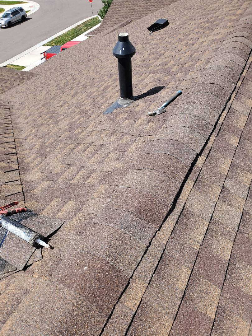 Parker, CO - we are doing a roof repair for this house in Parker that had wind damage to the shingles after the last big wind storm. It blew off a bunch of ridge shingles that need to be replaced.